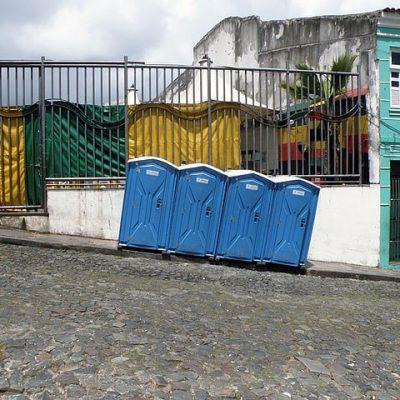 porta potty on a hill