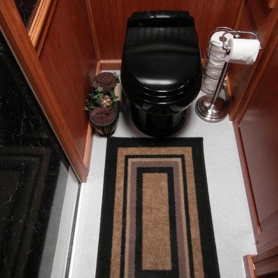 portable-toilets-with-oak-finish-walls.jpg
